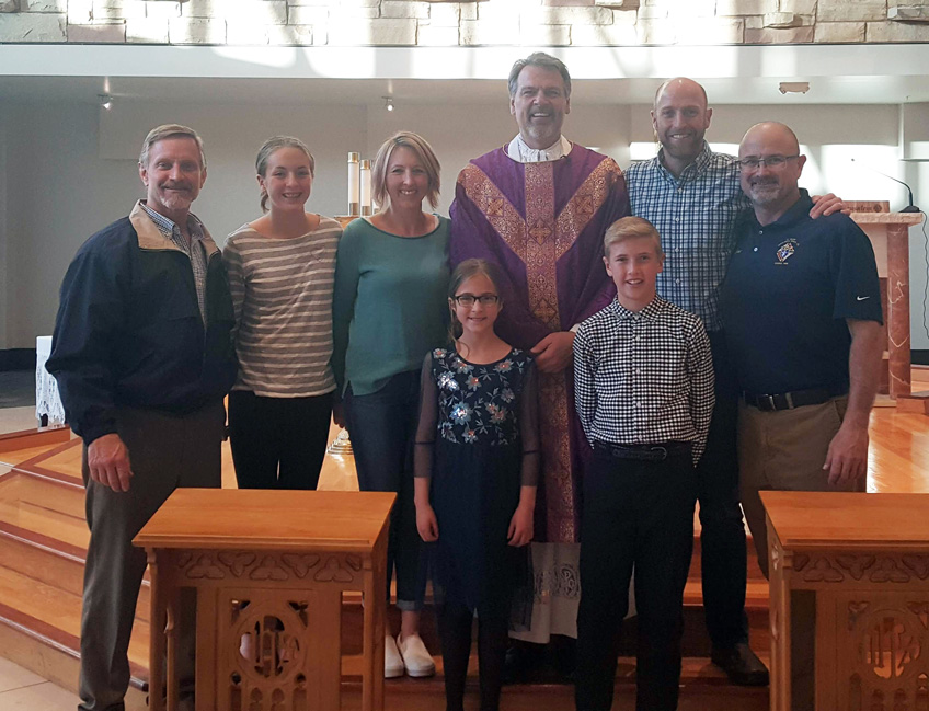 March Knights' Family of the Month. From left: Family Committee Director Kurt Haneke, Anna, Amanda & Bridget Windholz, Father Bierbaum, Andrew & Eric Windholz and Grand Knight Chet Elder.