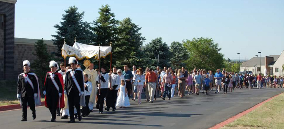 Corpus Christi Procession with First Holy Communion kiddos & Color Corps leading.