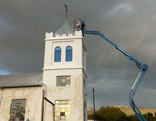 Knights fixing the cross among other restoration works for San Francisco Church.